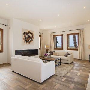 Mallorca Villa ALQUERIA BLANCA - NEUBAUFINCA MEERBLICK Wohnzimmer Kamin